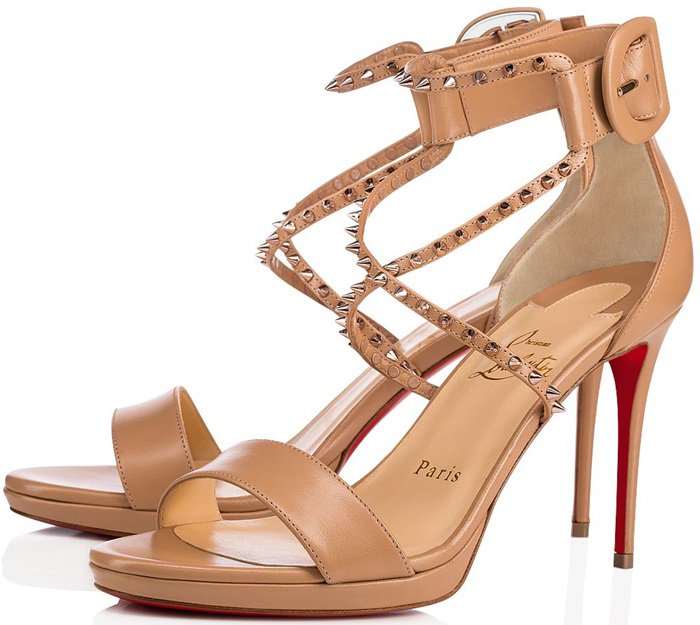 Pink bronze studs embellish the fine cross straps that curve around the ankle and end with a large covered buckle at the supersoft nude kidskin counter mounted on a 100mm heel