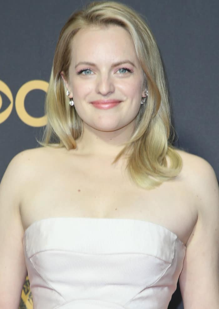 Elisabeth Moss young and vibrant in a blush pink Atelier Prabal Gurung midi that included a tulle skirt underlay