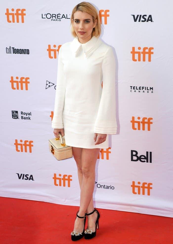"Emma Roberts in a crepe white shift dress and Chloe Gosselin ""Helix"" pumps."