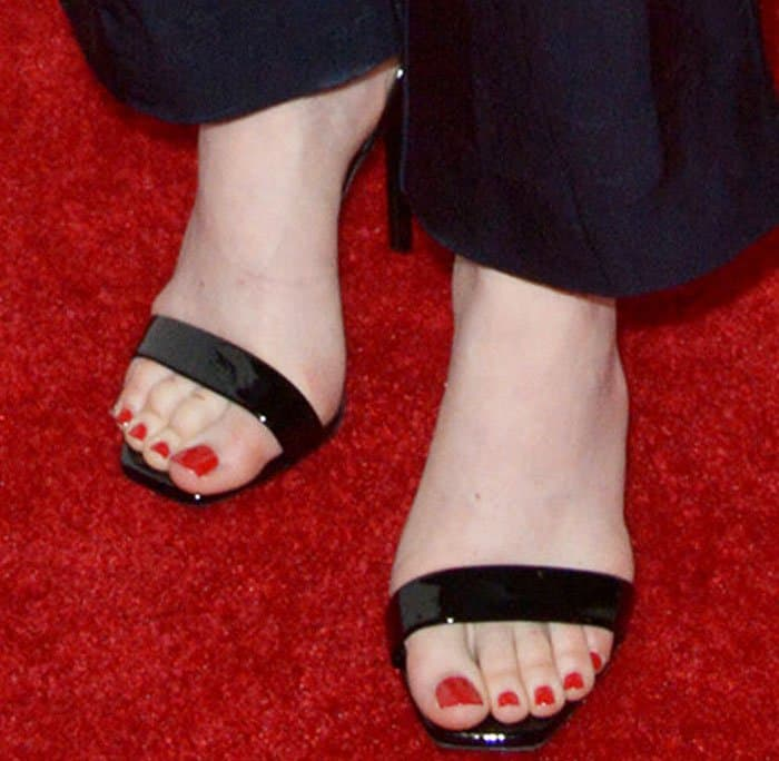 "Emma Stone showing off her feet in Saint Laurent's ""Amber"" patent sandals"
