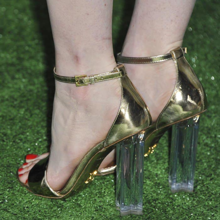 Emma showing off her pedicured feet in perspex Louis Vuitton sandals