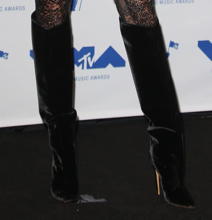Hailey Baldwin in a sheer Alexandre Vauthier jumpsuit and boots for the MTV VMAs 2017.
