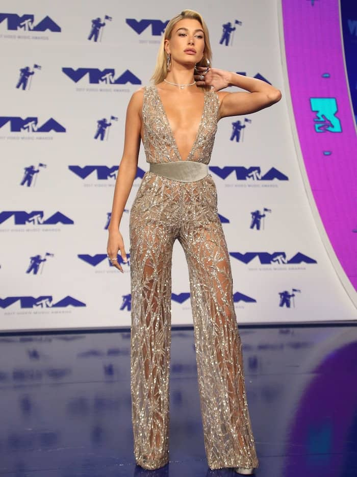 "Hailey Baldwin in a silver sheer Zuhair Murad jumpsuit and Jimmy Choo ""Pearl"" platform sandals."