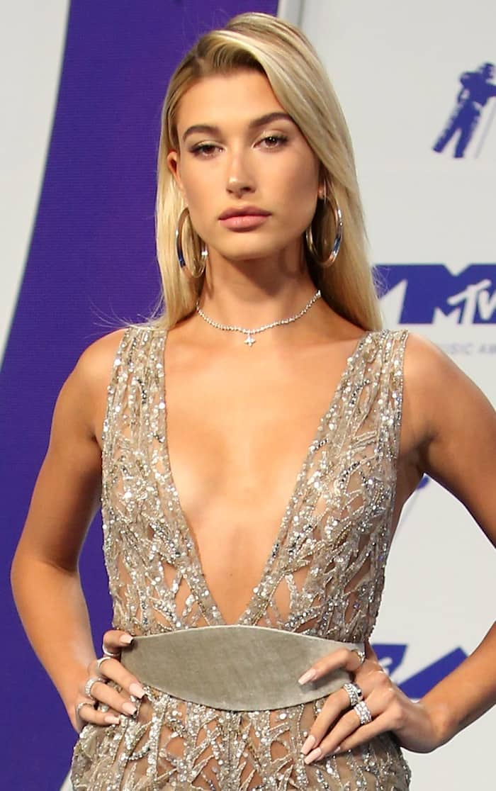 Hailey Baldwin walked the carpet and flashed her bottom in an embellished silver Zuhair Murad jumpsuit