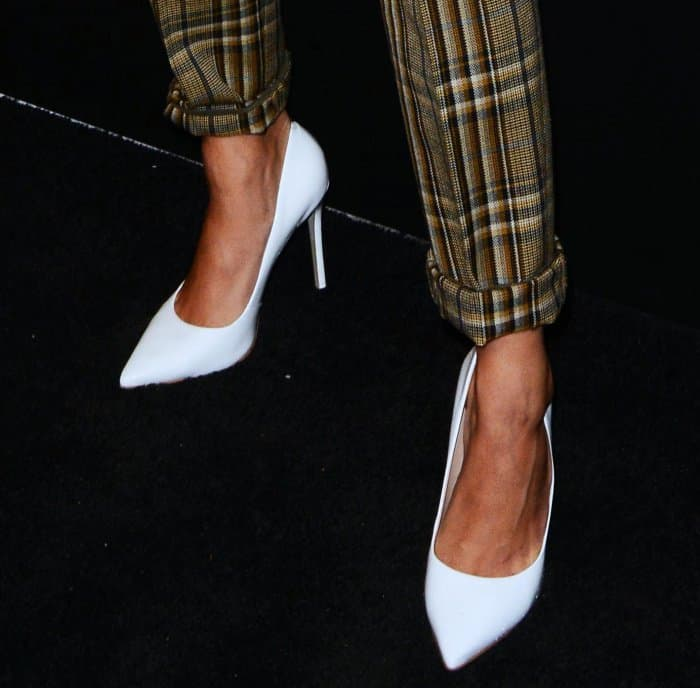 Hailey Baldwin in a plaid suit and white pumps for the NYFW kickoff party