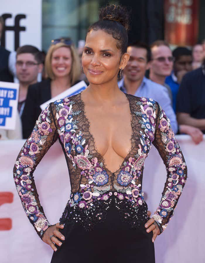 Halle Berry flashing cleavage in a Zuhair Murad Fall 2017 jumpsuit at the premiere of her new film 'Kings' at the 2017 Toronto International Film Festival held at Roy Thomson Hall in Toronto, Canada, on September 13, 2017