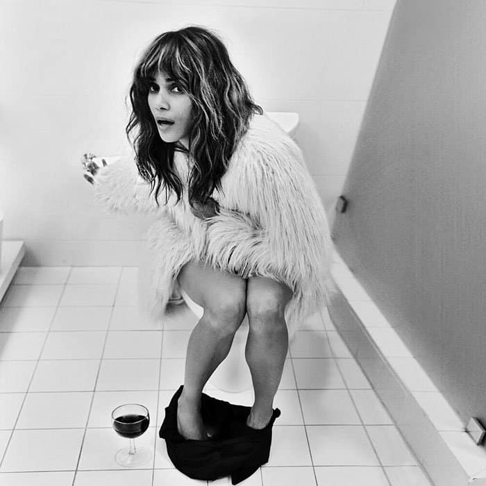 Halle shares a photo of herself on a bathroom and wine break