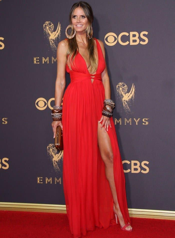 "Heidi Klum in a red Dundas resort 2018 maxi and red Giuseppe Zanotti ""Sophie"" sandals."
