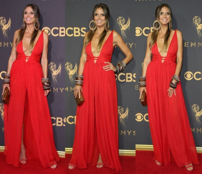 Heidi Klum accessorized with wooden cuffs, large hoop earrings and a gorgeous embellished wood clutch from Atelier Swarovski by Fiona Kotur