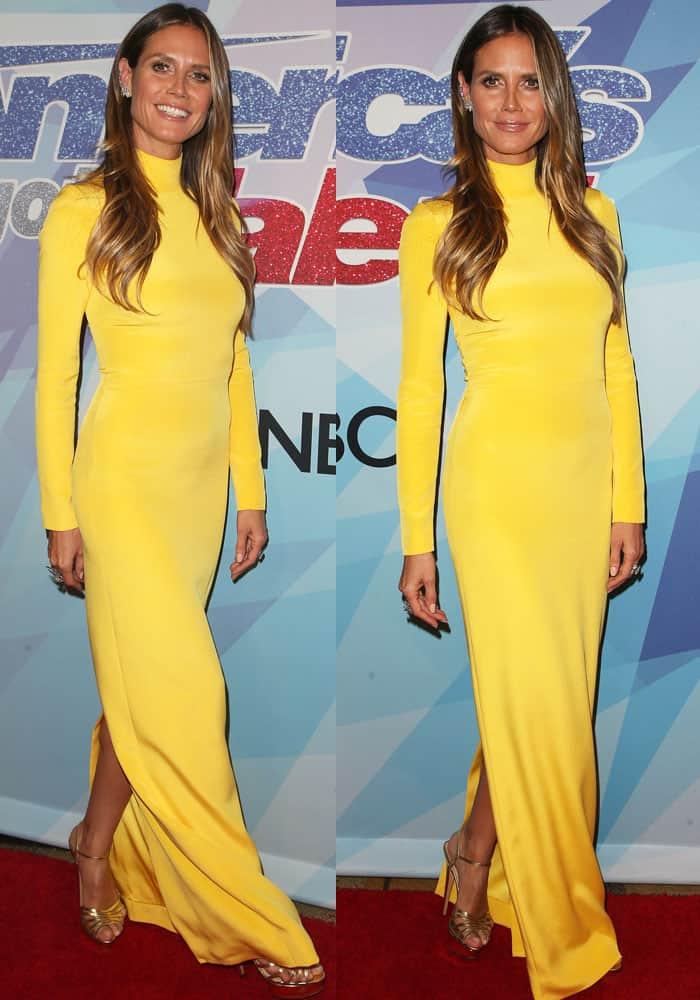 Heidi went for simplicity in a golden yellow dress by Christian Siriano