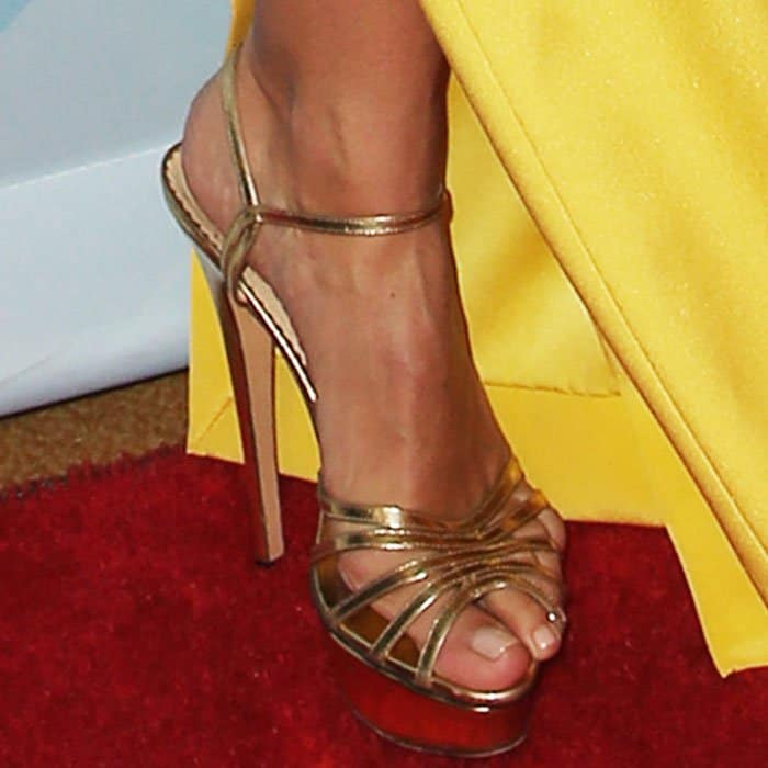 "The model looked statuesque in a pair of Charlotte Olympia ""Gilda"" platform sandals"