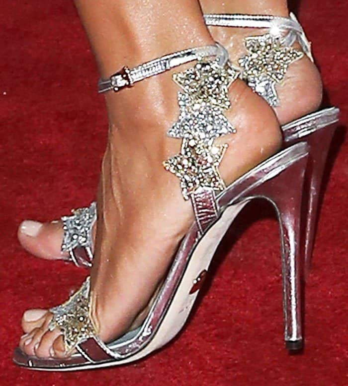 "Heidi piles on the glitter with a pair of Chiara Ferragni ""Star"" sandals"
