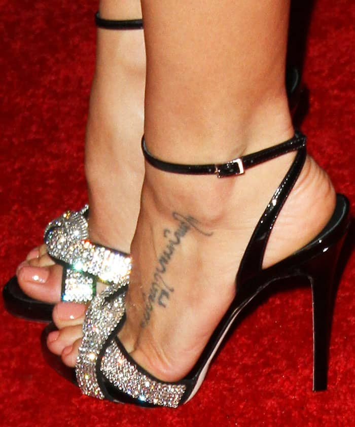 Jenna is decked out in Swarovski crystals in a pair of Giuseppe Zanotti sandals