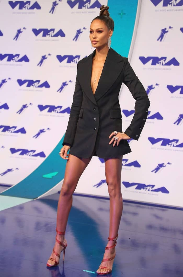 Joan Smalls flaunted her legs in a plunging tuxedo dress from H&M Studio