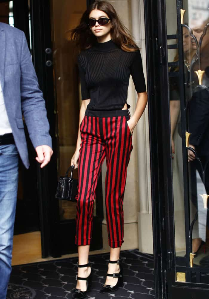 Kaia looked every bit a model in a bodysuit and The Kooples striped pants