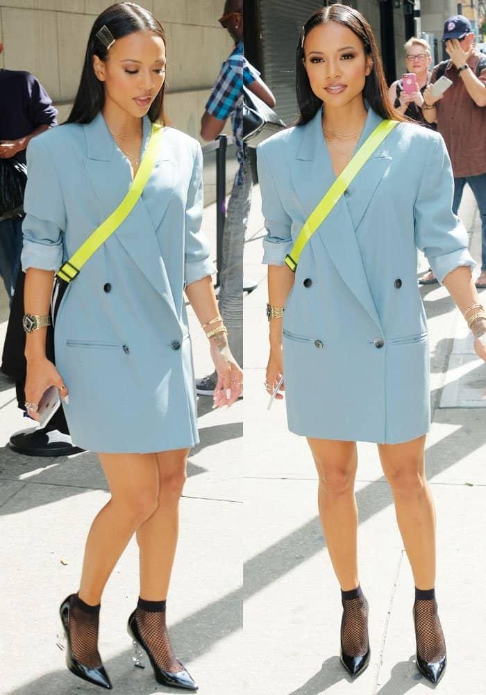 Karrueche looks flawless in an oversized double-breasted dress