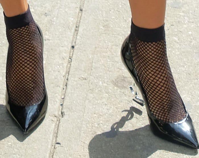 "Karrueche matches stocking socks with her Saint Laurent ""Opyum"" pumps"
