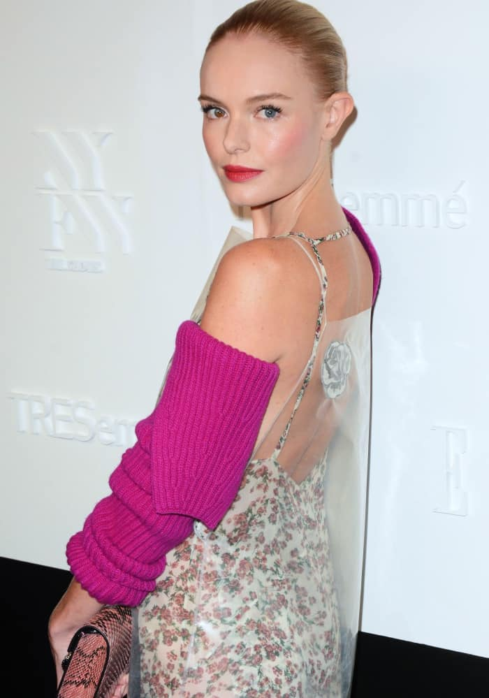 Kate Bosworth in a floral, coated shift dress paired with separate pink wool and cashmere sleeves