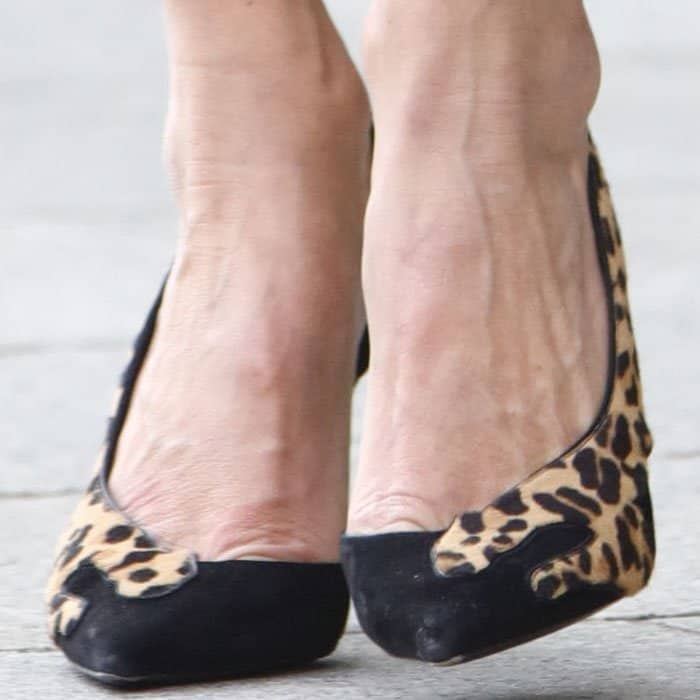 """The model steps out in a pair of Saint Laurent """"Anja"""" pumps"""