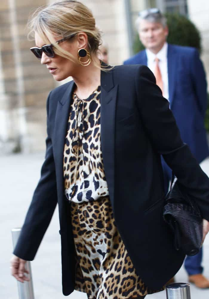The day before, Kate was seen out and about in a leopard print dress