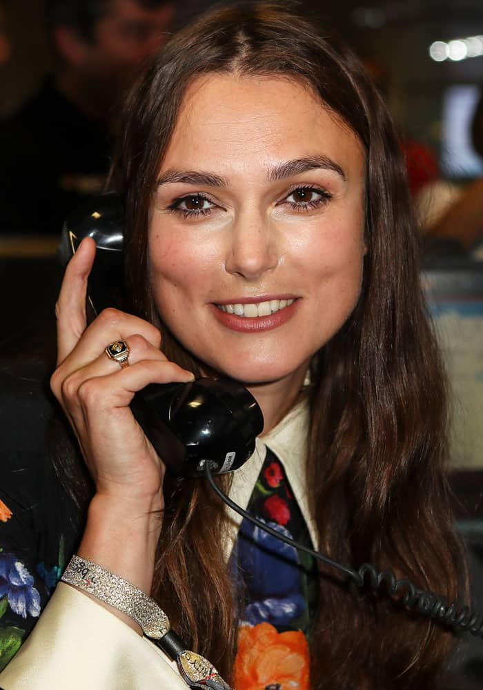 Keira flashes a smile as she takes a phone call from a willing donor