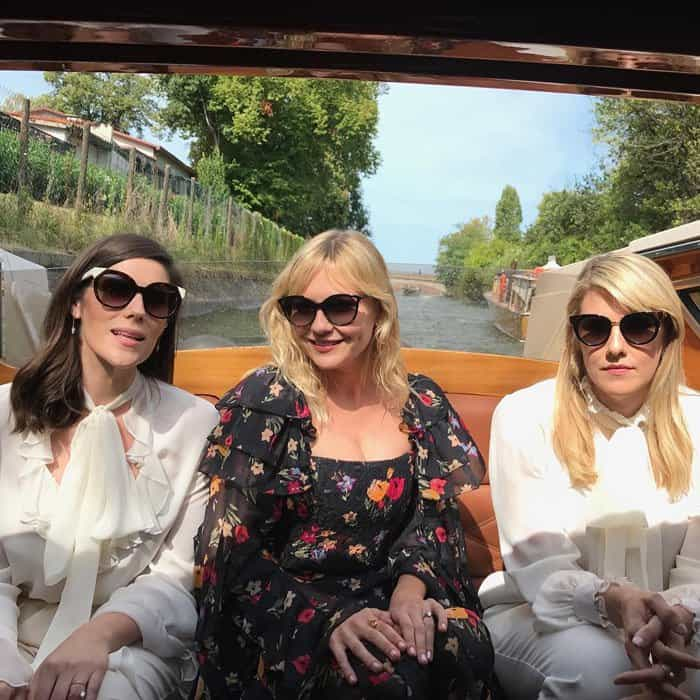 "The actress takes a boat photo with ""Woodshock"" directors Laura and Kate Mulleavy"