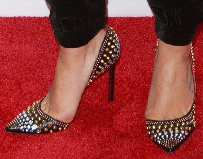 Lea dressed up her luxurious sleepwear with studded pumps by Cesare Paciotti