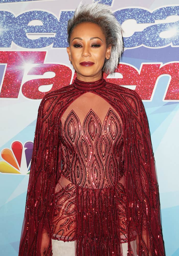 Mel B. matches her red outfit with red-toned makeup