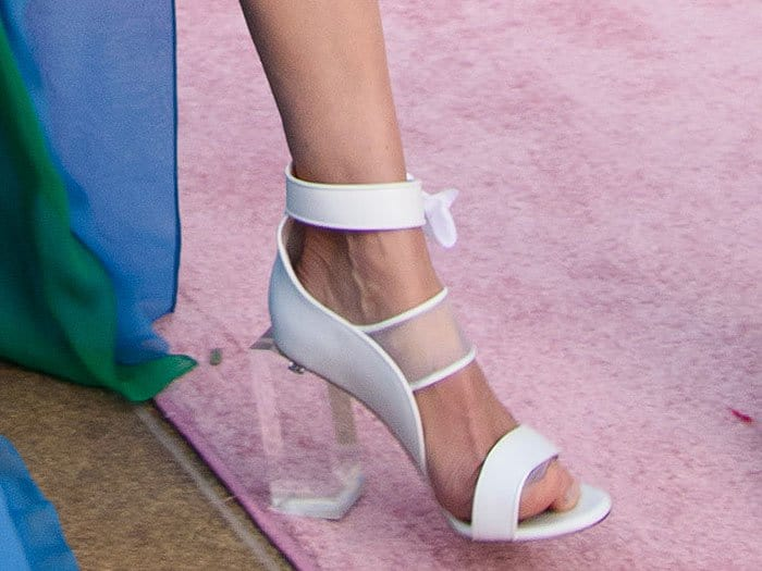 Closeups of the white Prabal Gurung Spring/Summer 2018 sandals with clear block heels onMichelle Monaghan.