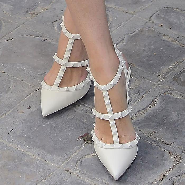 "Closeup of Nicky Hilton's Valentino ""Rockstud"" white t-strap pumps."