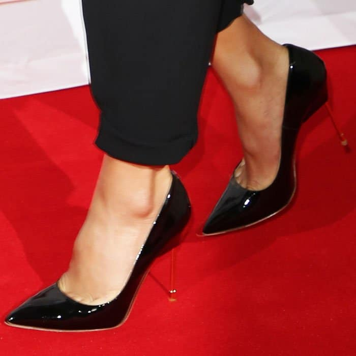 "Nicole keeps things classy with a pair of Kurt Geiger ""Britton"" pumps in patent leather"