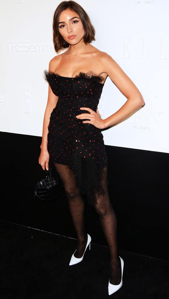 Olivia donned a polka-dot LBD from Carmen March and white pumps