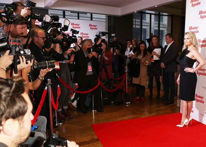Paparazzi hound Reese at her movie premiere in London