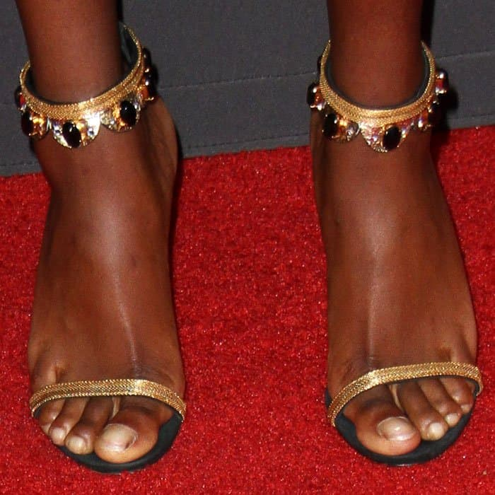 Hey, Cleopatra: the actress wears a pair of bronze sandals embellished with black stones
