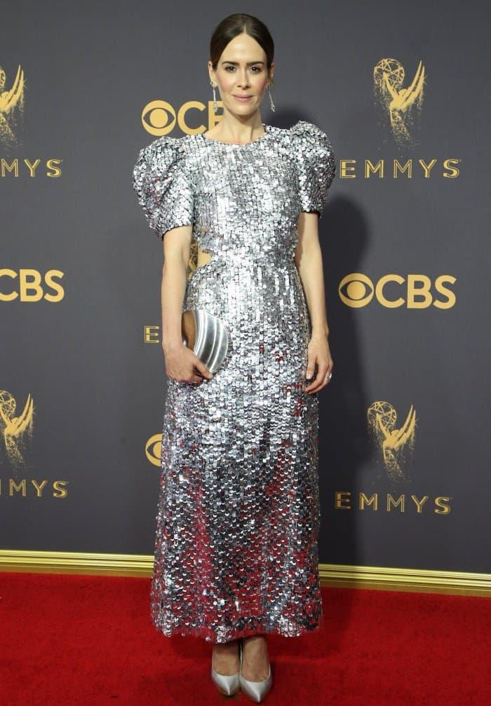 Sarah Paulson in a silver sequined Carolina Herrera dress and matching silver Stuart Weitzman pumps.