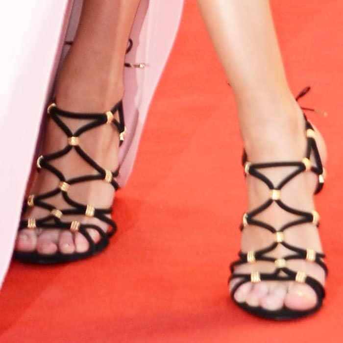 Stella contrasted her sweet dress with a pair of black-and-gold sandals by Salvatore Ferragamo