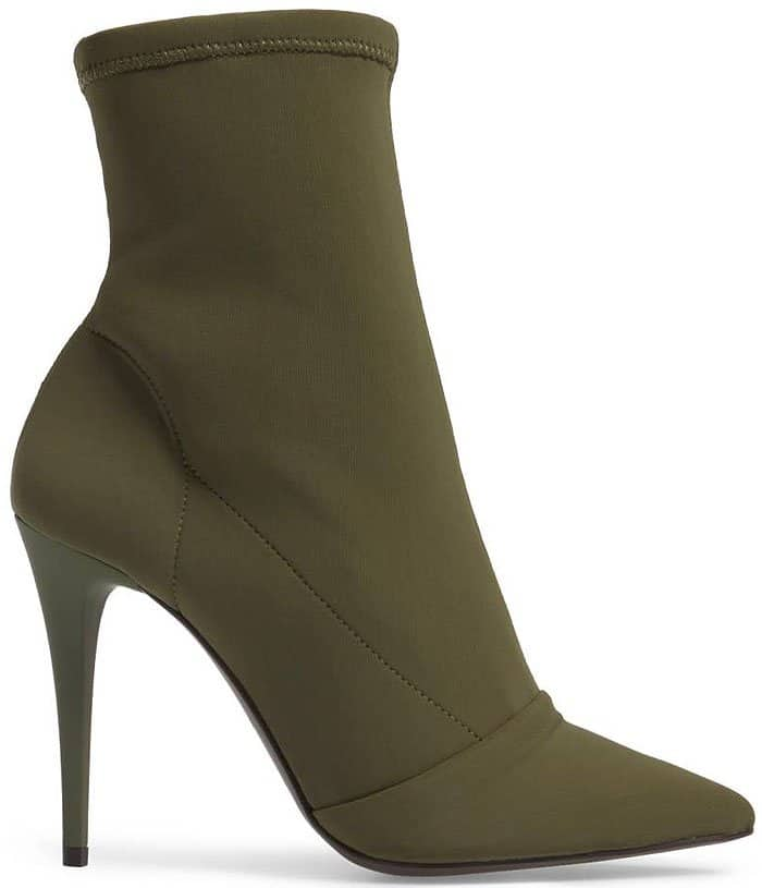 Dial up the drama in a pointy-toe boot balanced on a lofty stiletto heel and topped with a stretch shaft for a sock-like fit