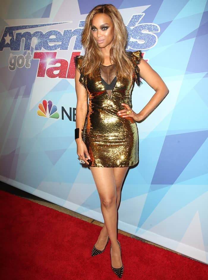 Tyra Banks sparkled in a gold sequin frock at NBC's 'America's Got Talent' Season 12 Live Show in Hollywood on September 6, 2017