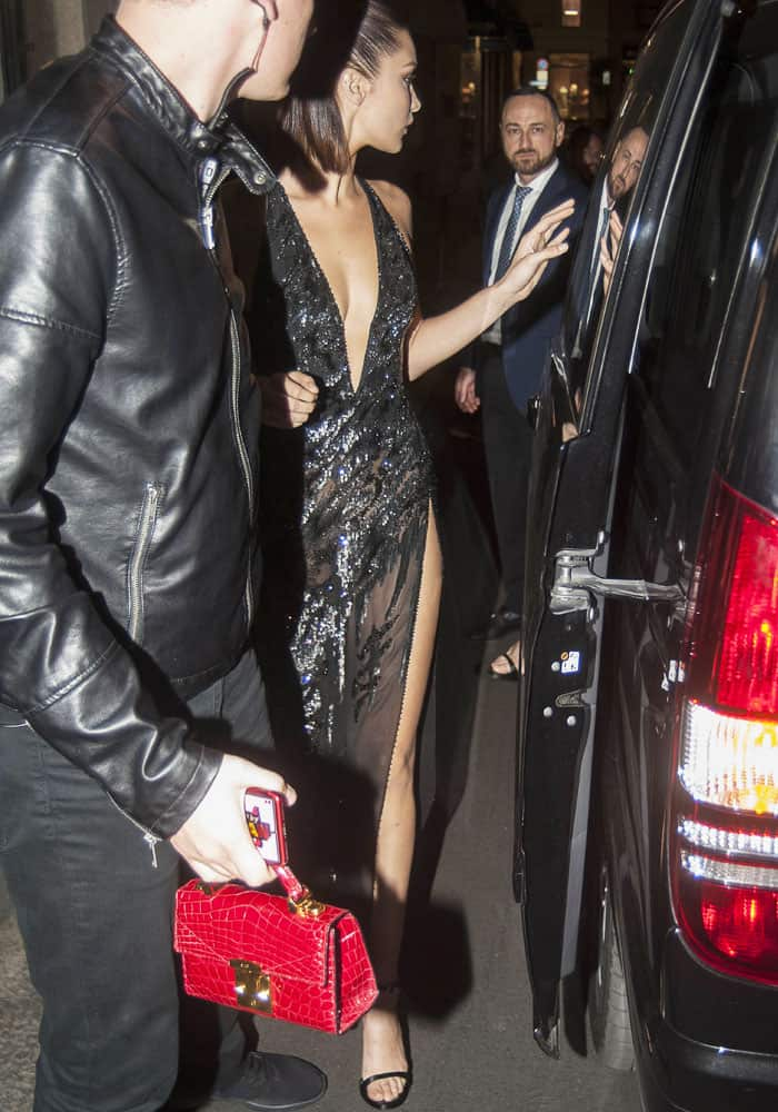 Bella Hadid remained within her older sister's peripheral throughout the night