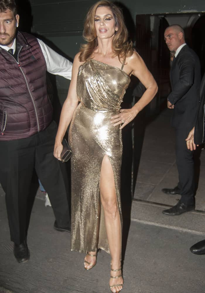 The 51-year-old still looked svelte in her gold Versace dress