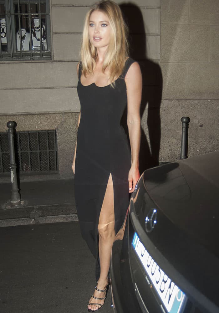 Doutzen leaves the Versace show in her iconic backless dress