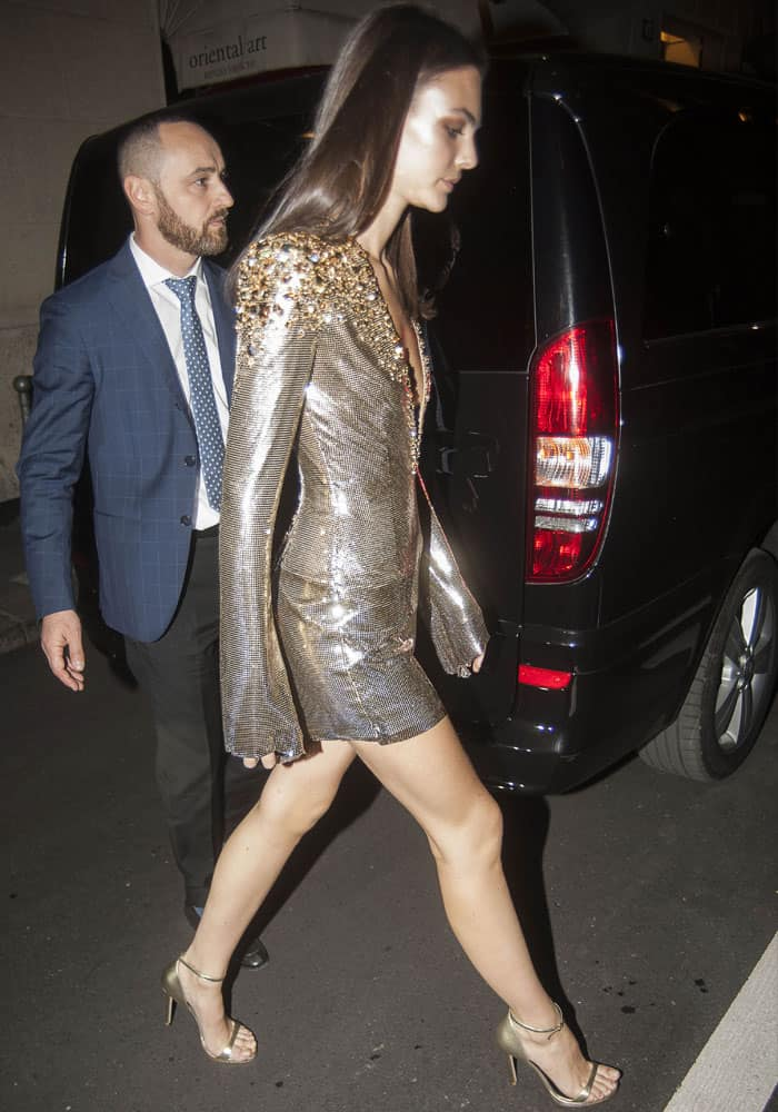 Vittoria Ceretti trails behind her good friend Gigi Hadid as she exits the party