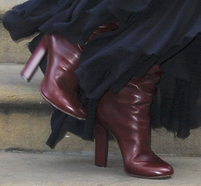 Victoria wears the heel boot from her latest collection
