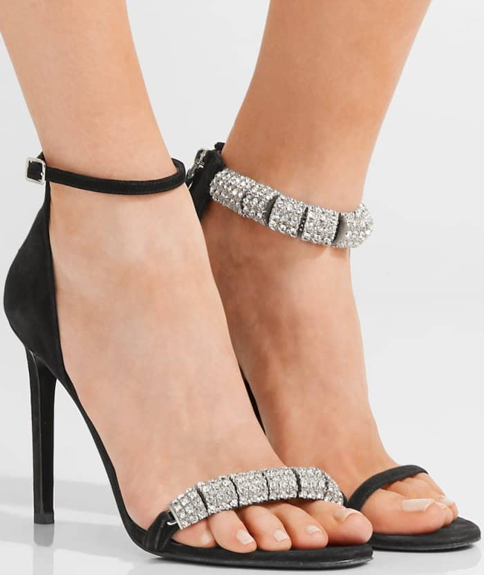 Rows of crystals dazzle and shine on a lofty, calfskin-suede sandal finished with a slim ankle strap