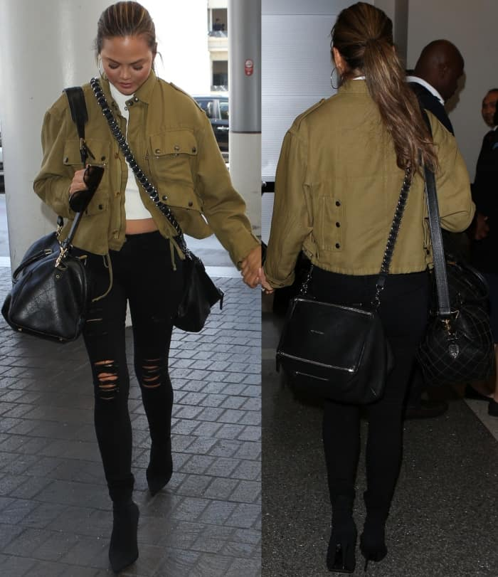 Chrissy Teigen wearing a Faith Connexion military jacket, Off-White top, Frame skinny jeans, and Balenciaga stretch-jersey sock boots at LAX