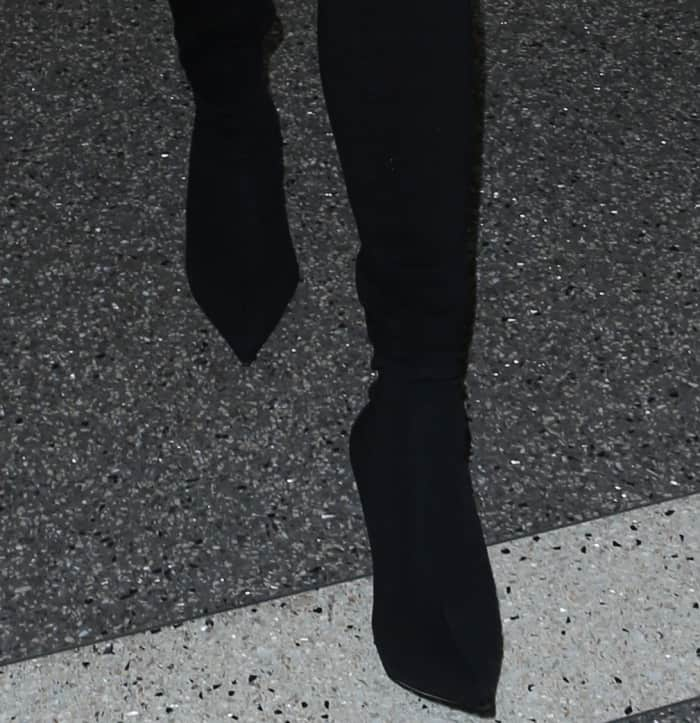 Chrissy Teigen wearing Balenciaga stretch-jersey sock boots at LAX