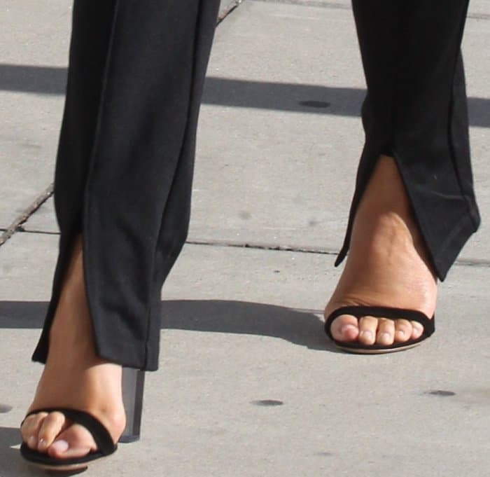 Chrissy Teigen wearing black ankle-strap sandals with clear heels while out and about in LA