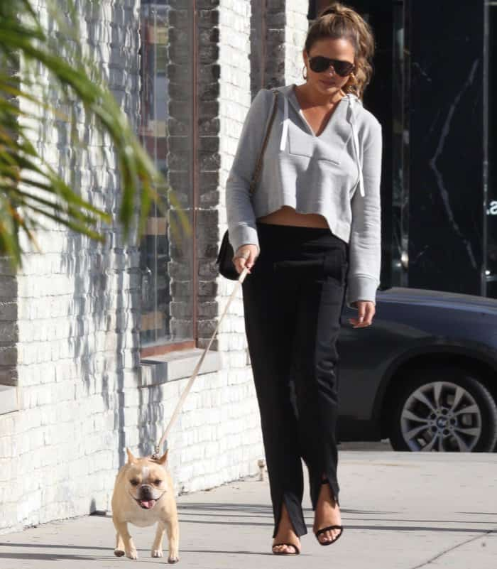 Chrissy Teigen wearing an A.L.C. ensemble and black ankle-strap sandals with clear heels while out and about in LA