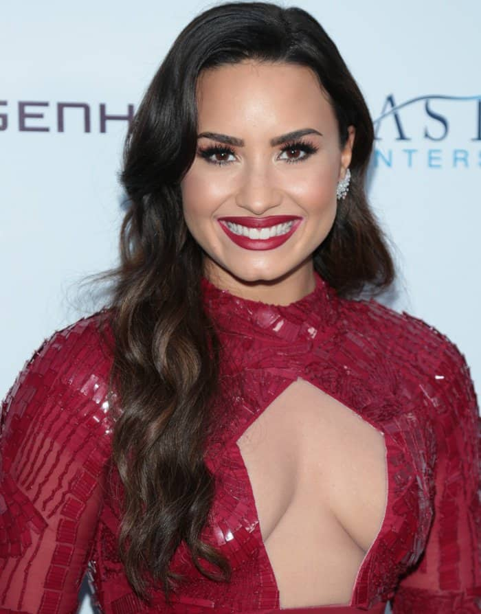 Demi Lovato wearing a red Bibhu Mohapatra Fall 2017 dress at the Brent Shapiro Foundation for Alcohol and Drug Prevention 2017 Summer Spectacular