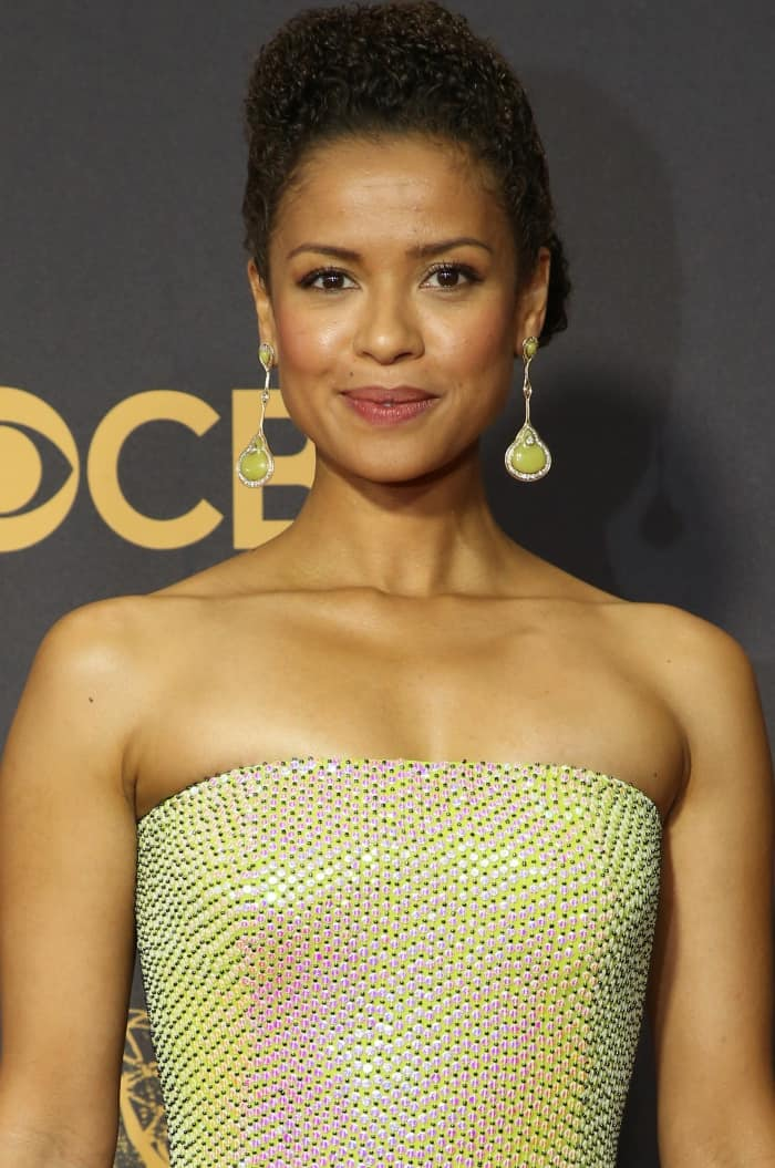 Gugu Mbatha-Raw swept her hair up to show off her flawless beauty look and statement drop earrings